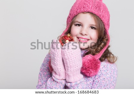 036602da93e8e Lovely winter little girl with christmas tree toy. Cute girl in woolen  accessories. Baby