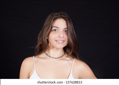 Lovely woman with long brown hair, looking at the camera with a happy smile