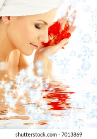 lovely woman with red flower petals and snowflakes in water