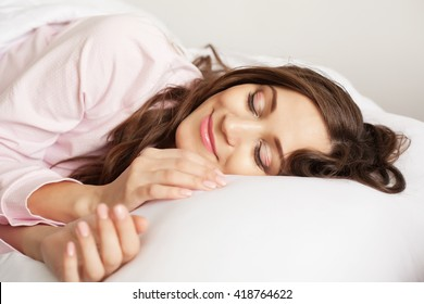 Lovely woman is sleeping in bed