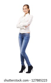 Lovely woman in white shirt and blue jeans, isolated on white