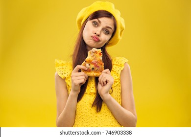 lovely woman in yellow in hand delicious pizza, food
