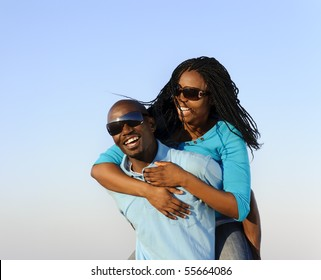 Lovely young African American couple together outdoors