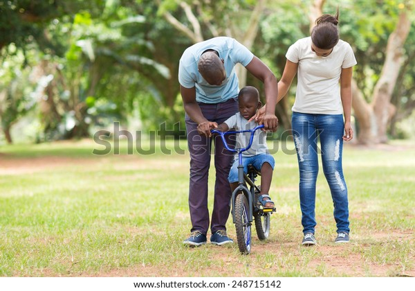 lovely young african family having quality time outdoors