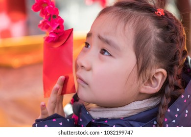 The lovely young asian girl in the new year