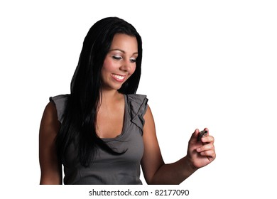 A lovely young black-haired model holds a heavy marker, allowing you to easily insert text or drawings as if she's creating them.  Isolated on white background.
