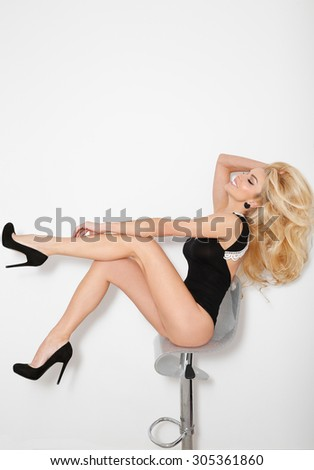 65c4fa87f60d Lovely young blonde hair the woman are sitting on a chair in pyjamas sexy  smiling