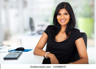 lovely young businesswoman sitting in modern office