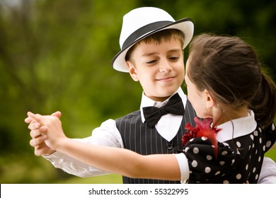 Lovely young couple dancing and having fun. Focus on the boy face. More images with the same models.