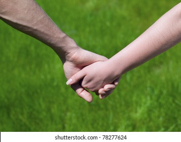 Lovely Young couple hold each other's hand