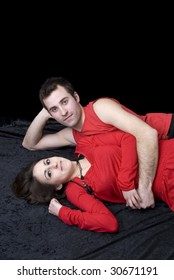 lovely young couple lying on the floor