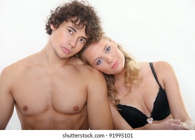 Lovely young couple on the white background
