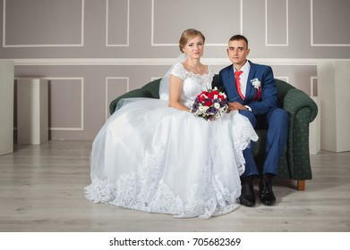 Lovely young couple in studio interior. Happy wedding.