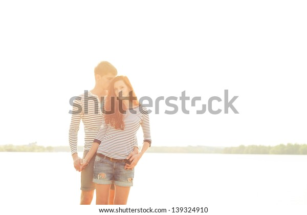lovely young couple in sunny day on beach