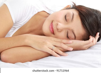 lovely young female sleeping on the bed