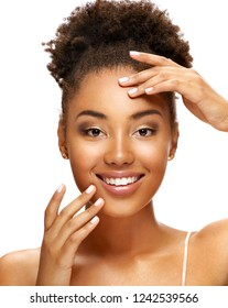 Lovely young girl touching her face. Photo of young african american girl with natural makeup. Youth and skin care concept