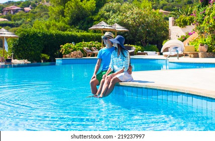 Lovely young romantic couple near swimming pool at exotic resort