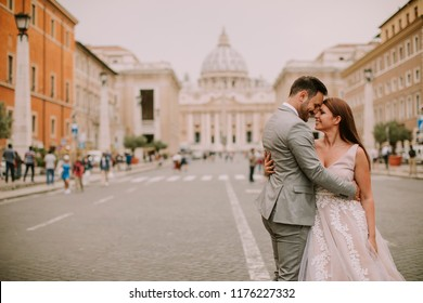 Lovely young wedding couple by Saint Peter cathedral in Vatican