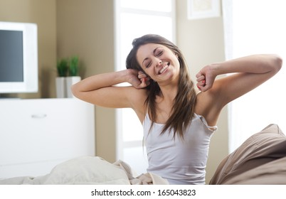 A lovely young woman stretching in the morning