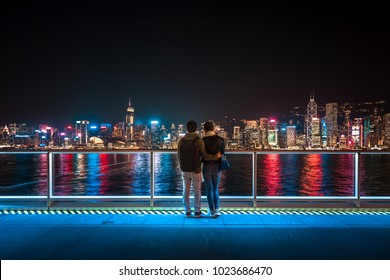 Lover stand in front of Hong Kong Victoria Harbor