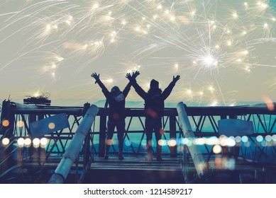 Lover women and men asians. Stand and raise hands watch the fireworks. Happy on the day of the celebration New year day on Mountain in Thailand.