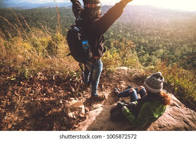 Lover women and men asians travel relax in the holiday. Admire the atmosphere landscape on the Moutain. Mountain Park happily. In Thailand