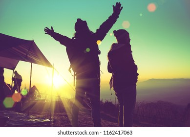 Lover women and men asians travel relax camping in the holiday. On the Moutain. Stand watch the sun rise. Thailand