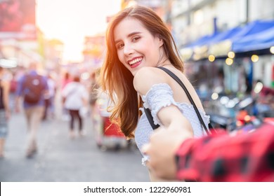 Lover women and men asians travel relax in the holiday. Hold hands Market in Bangkok Thailand , traveler and tourist concept.