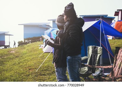 Lover women and men asians travel relax camping in the holiday. Camping In the winter.Read books, drink coffee. Thailand