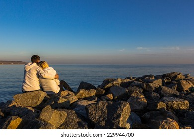 Lovers admire the sea view