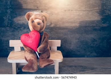 Lovers bear and red chocolate heart.