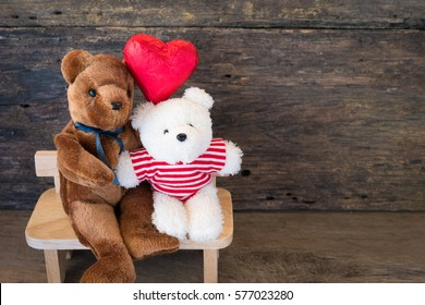 Lovers bear and red chocolate heart. concept love is no skin or race