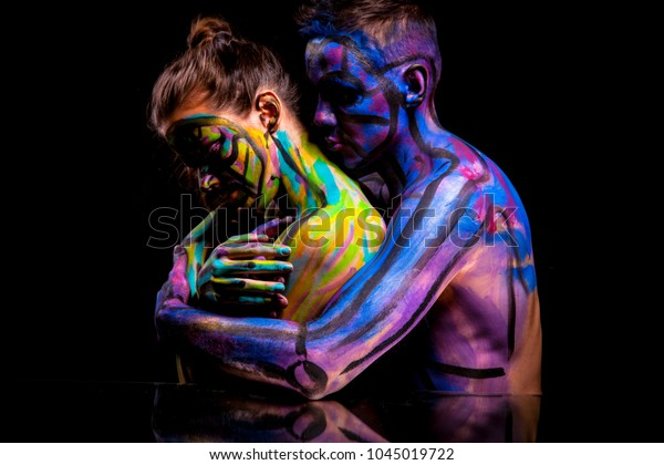 Lovers couple in paint. Abstract art portrait. Love. Body art.