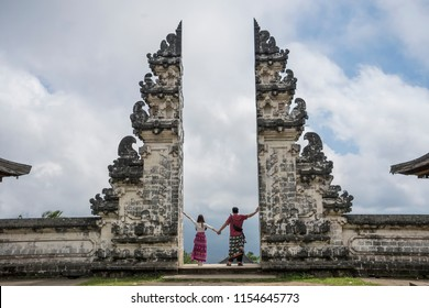 Lovers go to honeymoon in the gate of a temple, Bali, Indonesia