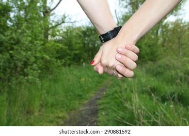 Lovers hands together