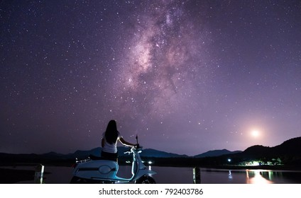 Lovers are happy in the night with the Milky Way and stars in the beautiful night sky.