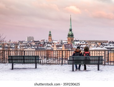 Lovers at the hill are looking over the Stockholm Old Town. This winter was relatively warm but finally the season for snow has come here.