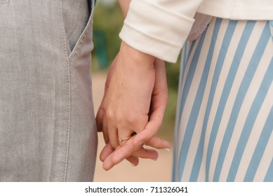 lovers hold each other's hands