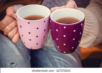 Lovers holding cups of tea