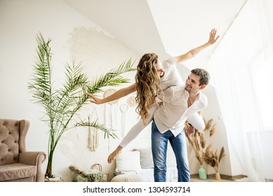 Lovers hug each other in the large bedroom. Love story.