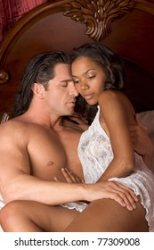 Lovers - Interracial sensual couple making love in bed