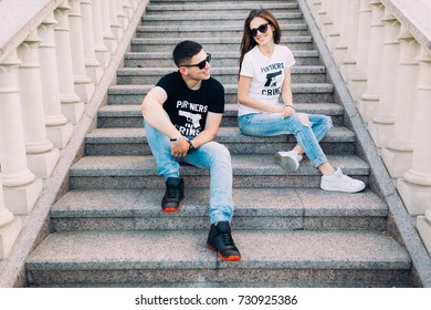 """lovers on the steps. the inscription on the T-shirt """" PARTNERS IN CRIME"""""""