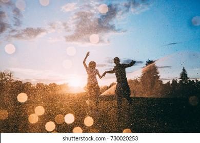 lovers in the rain spray