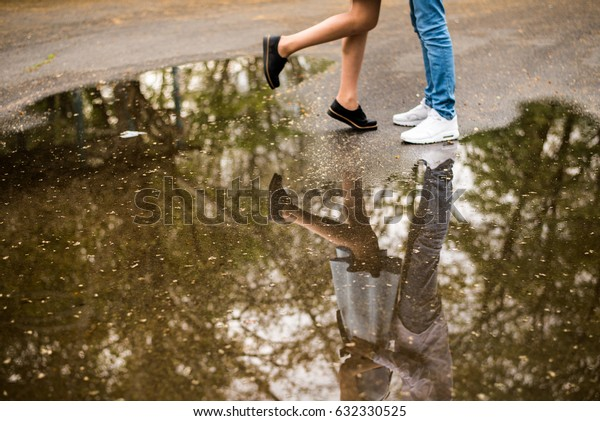 lovers and reflection on water, spring time love boy and girlfriend