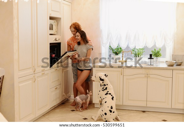 the lovers rejoice and indulge in the kitchen