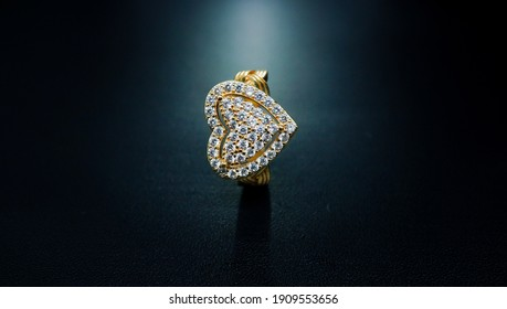 lover's ring in gold color with love motif and diamond specks