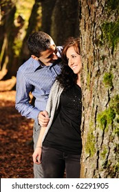 Lovers teenagers in nature talking with each other and falling in love :) - trees, forest, fall, yellow and red ground