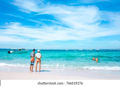 Lovers of tourists are enjoying at the sea and the clear sky at Koh Larn Island, Pattaya, Thailand.
