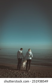 Lovers walk along the shore of a tropical beach with a dog. Book cover