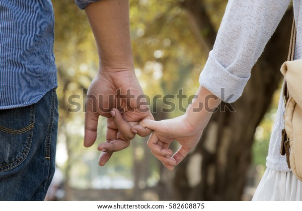 lovers walking hand in hand